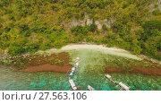 Купить «Aerial view Sunset and Atwayan beach with rocks. Travelling tour in Asia: Palawan, Philippines.», видеоролик № 27563106, снято 4 февраля 2018 г. (c) Mikhail Davidovich / Фотобанк Лори