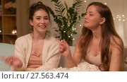 Купить «female bloggers recording home video», видеоролик № 27563474, снято 25 января 2018 г. (c) Syda Productions / Фотобанк Лори