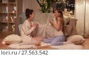 Купить «happy female friends at home pajama party», видеоролик № 27563542, снято 25 января 2018 г. (c) Syda Productions / Фотобанк Лори