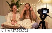 Купить «female bloggers with camera recording home video», видеоролик № 27563702, снято 25 января 2018 г. (c) Syda Productions / Фотобанк Лори