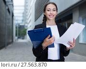 Купить «Businesswoman is examining documents», фото № 27563870, снято 26 июня 2017 г. (c) Яков Филимонов / Фотобанк Лори