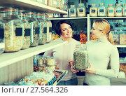 Купить «Female customers selecting various herbs», фото № 27564326, снято 15 ноября 2018 г. (c) Яков Филимонов / Фотобанк Лори