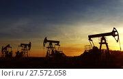 Купить «Many working oil pumps silhouette against sunset», видеоролик № 27572058, снято 18 октября 2017 г. (c) Михаил Коханчиков / Фотобанк Лори