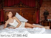 Купить «young woman wearing white silk night lingerie», фото № 27580442, снято 6 апреля 2017 г. (c) katalinks / Фотобанк Лори