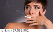 Купить «Young Woman Inhales Cigarette Smoke INtimate Smoker Portrait», фото № 27582902, снято 24 мая 2018 г. (c) PantherMedia / Фотобанк Лори
