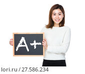 Купить «Asian woman with chalkboard and showing mark A plus», фото № 27586234, снято 5 июня 2020 г. (c) PantherMedia / Фотобанк Лори