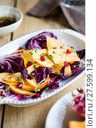 Купить «Persimmon with Radicchio and Pomegranate salad», фото № 27599134, снято 24 мая 2018 г. (c) PantherMedia / Фотобанк Лори