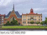 Купить «View of Immanuel Church (Immanuelskyrkan) by the Nissan river in Halmstad, Halland County, Sweden.», фото № 27600950, снято 11 августа 2013 г. (c) age Fotostock / Фотобанк Лори