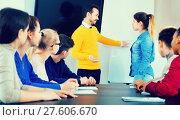 Купить «Female student answering teacher's question at writing board», фото № 27606670, снято 28 февраля 2017 г. (c) Яков Филимонов / Фотобанк Лори
