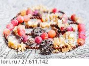 Купить «tangled necklace from natural gemstones close up», фото № 27611142, снято 7 апреля 2020 г. (c) PantherMedia / Фотобанк Лори