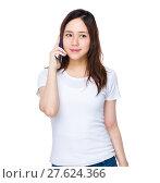 Купить «Asian woman talk to cellphone», фото № 27624366, снято 16 января 2019 г. (c) PantherMedia / Фотобанк Лори