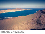 Купить «view of graciosa island from mirador del rio,lanzarote island,canary islands,spain», фото № 27625962, снято 16 декабря 2018 г. (c) PantherMedia / Фотобанк Лори