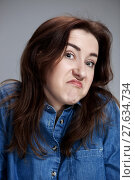 Купить «Portrait of young woman with shocked facial expression», фото № 27634734, снято 24 марта 2019 г. (c) PantherMedia / Фотобанк Лори