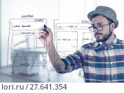 Купить «web designer drawing website development wireframe», фото № 27641354, снято 26 марта 2019 г. (c) PantherMedia / Фотобанк Лори