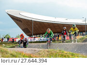 Купить «Competitors take part in the BMX Motos Finals on the opening day of the Prudential RideLondon event 2016 at the Lee Valley VeloPark Featuring: Atmosphere...», фото № 27644394, снято 29 июля 2016 г. (c) age Fotostock / Фотобанк Лори