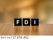 Купить «FDI or Foreign direct investment on black block», фото № 27656462, снято 22 марта 2019 г. (c) PantherMedia / Фотобанк Лори