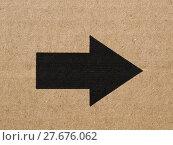 Купить «Black arrow on cardboard», фото № 27676062, снято 25 апреля 2019 г. (c) PantherMedia / Фотобанк Лори