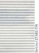 Купить «White horizontal roller shutter blinds», фото № 27683174, снято 21 мая 2019 г. (c) PantherMedia / Фотобанк Лори