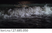 Купить «Night view of the dark sea waves rolling in on the shore», видеоролик № 27685050, снято 26 марта 2019 г. (c) Данил Руденко / Фотобанк Лори