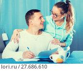 Купить «Couple signing papers», фото № 27686610, снято 18 марта 2017 г. (c) Яков Филимонов / Фотобанк Лори