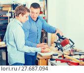 Купить «Woodworker working with pupil», фото № 27687094, снято 17 мая 2017 г. (c) Яков Филимонов / Фотобанк Лори