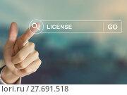 Купить «business hand clicking license button on search toolbar», фото № 27691518, снято 22 июня 2018 г. (c) PantherMedia / Фотобанк Лори