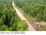 Купить «Highway in forest. Aland Islands, Finland», фото № 27692582, снято 25 июля 2013 г. (c) Валерия Попова / Фотобанк Лори