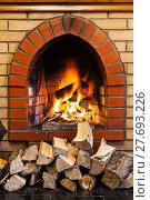 Купить «stack of wood and fire in indoor brick fireplac», фото № 27693226, снято 26 марта 2019 г. (c) PantherMedia / Фотобанк Лори