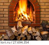 Купить «stack of firewood and fire in brick fireplace», фото № 27694354, снято 26 марта 2019 г. (c) PantherMedia / Фотобанк Лори