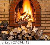 Купить «pile of firewood and fire in brick fireplace», фото № 27694418, снято 26 марта 2019 г. (c) PantherMedia / Фотобанк Лори
