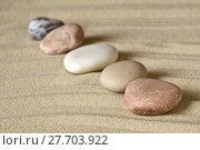 Купить «Камни сложенные в ряд на песке», фото № 27703922, снято 1 мая 2017 г. (c) Евгений Прокофьев / Фотобанк Лори