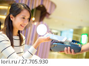 Купить «Woman pay with mobile phone by NFC technology», фото № 27705930, снято 22 января 2020 г. (c) PantherMedia / Фотобанк Лори