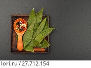 Купить «Bay leaves and pepper on black chalkboard», фото № 27712154, снято 20 июля 2019 г. (c) PantherMedia / Фотобанк Лори