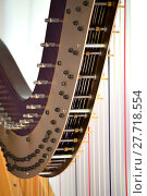 Купить «Pedal harp tuning mechanisms closeup», фото № 27718554, снято 20 марта 2018 г. (c) PantherMedia / Фотобанк Лори