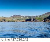 Купить «View to Dunquin from a fishing boat near the Slea Head on the Dingle Peninsula in Ireland with a clear deep blue sky», фото № 27726242, снято 26 марта 2019 г. (c) PantherMedia / Фотобанк Лори