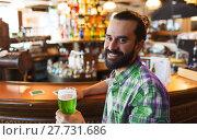 Купить «man drinking green beer at bar or pub», фото № 27731686, снято 22 апреля 2015 г. (c) Syda Productions / Фотобанк Лори