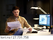Купить «designer with papers working at night office», фото № 27731758, снято 26 ноября 2017 г. (c) Syda Productions / Фотобанк Лори