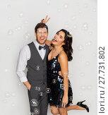 Купить «happy couple hugging in soap bubbles at party», фото № 27731802, снято 15 декабря 2017 г. (c) Syda Productions / Фотобанк Лори