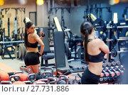 Купить «woman with smartphone taking mirror selfie in gym», фото № 27731886, снято 18 июля 2018 г. (c) Syda Productions / Фотобанк Лори