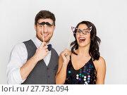Купить «happy couple with party props having fun», фото № 27732094, снято 15 декабря 2017 г. (c) Syda Productions / Фотобанк Лори