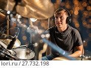 Купить «musician playing drum kit at concert over lights», фото № 27732198, снято 18 августа 2016 г. (c) Syda Productions / Фотобанк Лори