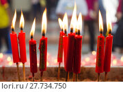 Купить «Burning red candle at chinese shrine for making merit in chinese new year festival. Pray for New Year,Lighting incense to Buddha.», фото № 27734750, снято 21 октября 2019 г. (c) PantherMedia / Фотобанк Лори