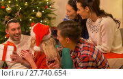 Купить «friends celebrating christmas and giving presents», видеоролик № 27740654, снято 22 декабря 2017 г. (c) Syda Productions / Фотобанк Лори