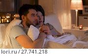 Купить «scared couple watching horror movie on tv at home», видеоролик № 27741218, снято 7 февраля 2018 г. (c) Syda Productions / Фотобанк Лори