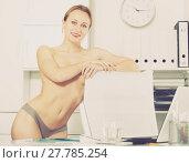 Купить «Female in pants in the office near the table», фото № 27785254, снято 24 апреля 2017 г. (c) Яков Филимонов / Фотобанк Лори