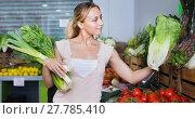 Купить «Portrait of woman shopping fresh green celery, leek and lettuce», фото № 27785410, снято 16 июля 2019 г. (c) Яков Филимонов / Фотобанк Лори