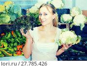 Купить «young woman buying cabbage at market», фото № 27785426, снято 21 января 2020 г. (c) Яков Филимонов / Фотобанк Лори