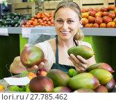 Купить «young woman selling mango at market», фото № 27785462, снято 18 июля 2019 г. (c) Яков Филимонов / Фотобанк Лори