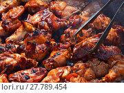Купить «Chicken buffalo wings cooked on smoke grill», фото № 27789454, снято 17 июля 2019 г. (c) PantherMedia / Фотобанк Лори