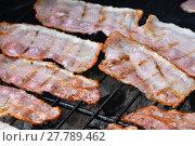 Купить «Crispy smoked bacon slices cooked on bbq grill», фото № 27789462, снято 17 июля 2019 г. (c) PantherMedia / Фотобанк Лори
